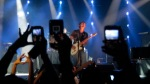Members of the audience take pictures on their mobile phones during a set by British singer-songwriter James Blunt who is performing a concert in Beirut, Lebanon, Monday June 27, 2011. (AP Photo/Hussein Malla)